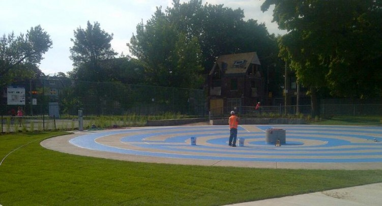 Labyrinth being painted on the wading pool in @withrowpark Join us Saturday at 10-30 to celebrate the opening! twitter-com-PaulaFletcher30-status-491595193322586112